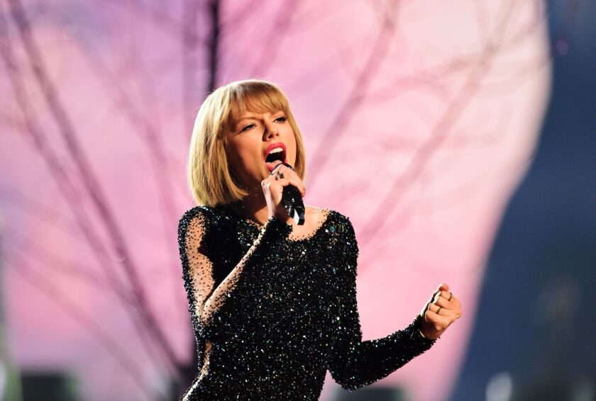 Taylor Swift opens the 58th Annual Grammy Awards show at Staples Center.