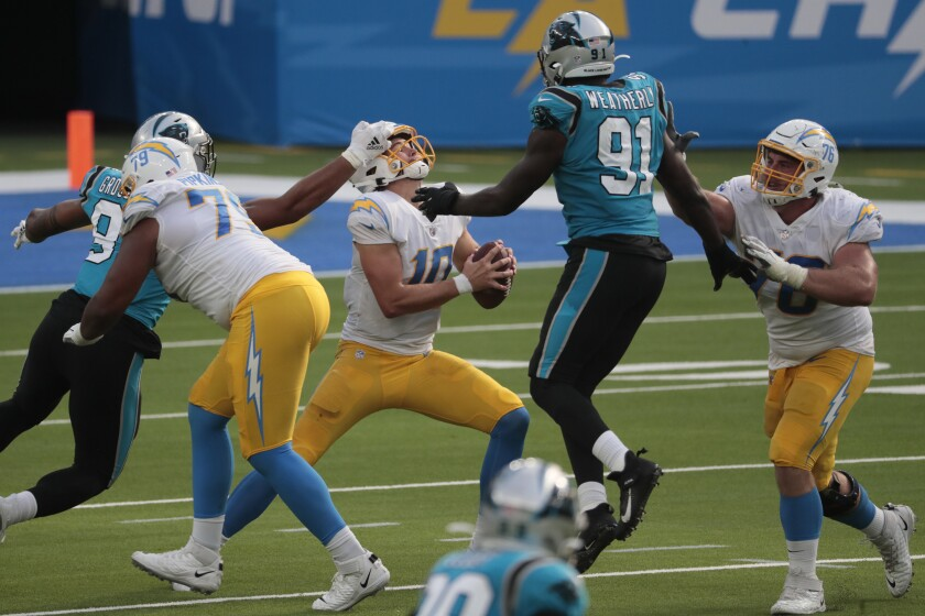 The Panthers' pass rush pressures Chargers quarterback Justin Herbert.