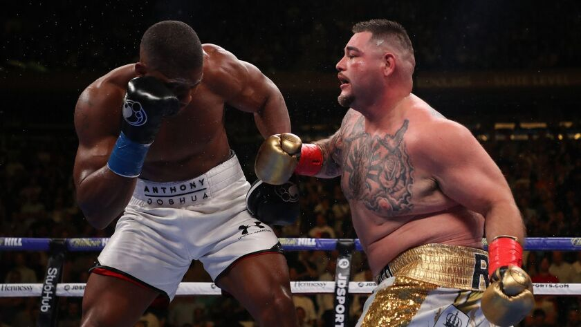 Andy Ruiz Jr., right, punches Anthony Joshua during their heavyweight title fight in New York on June 1. Ruiz won by TKO in an upset.