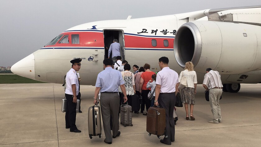 Passengers in Pyongyang board an Air Koryo flight headed for Beijing in June. The carrier was ranked as the worst in the world by Skytrax for the fourth straight year.