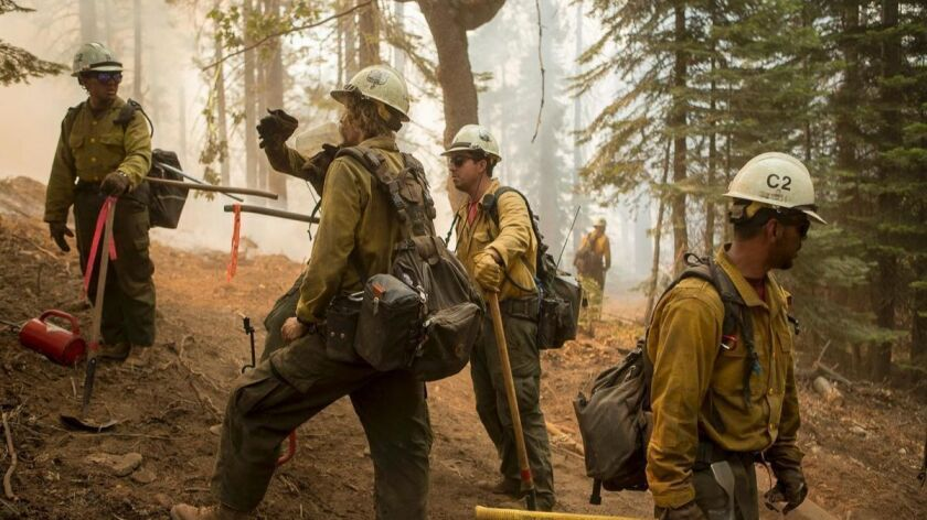 Firefighters last week near Mariposa, Calif., south of Yosemite National Park, were preparing for deployment to the Ferguson fire.