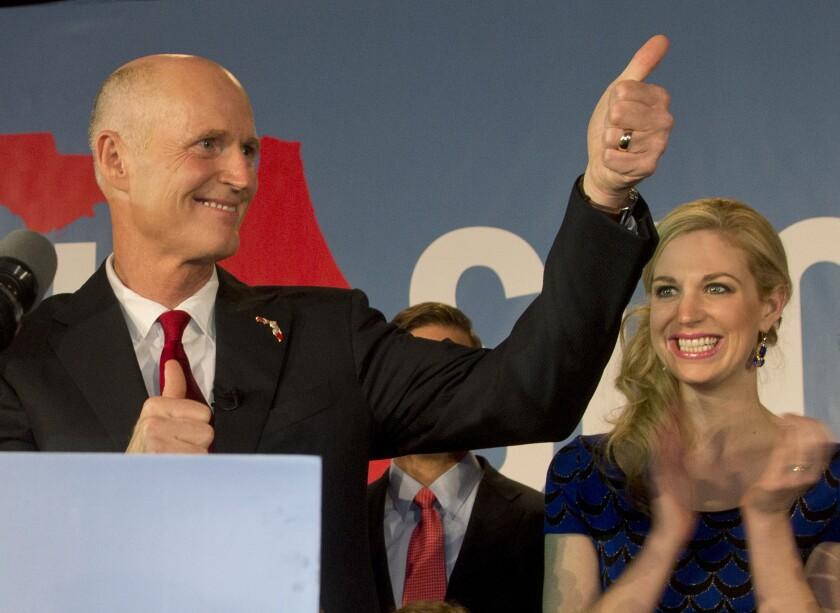 Florida Gov. Rick Scott gives a thumbs up to the crowd after defeating Democratic challenger, former Republican Charlie Crist, in Bonita Springs, Fla.