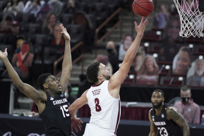 Alabama forward Alex Reese (3) drives to the hoop against South Carolina forward Wildens Leveque (15) during the second half of an NCAA college basketball game Tuesday, Feb. 9, 2021, in Columbia, S.C. Alabama won 81-78. (AP Photo/Sean Rayford)