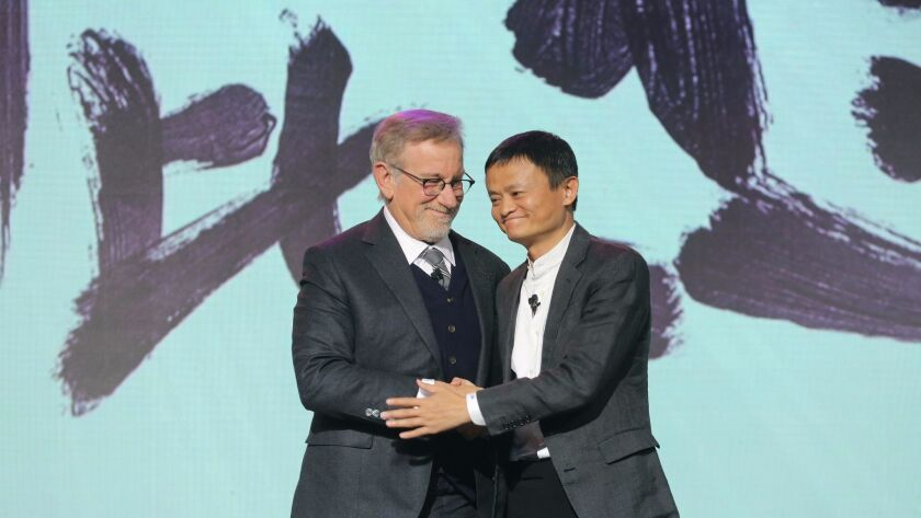 Steven Spielberg joins Alibaba Group's Jack Ma at a press event in Beijing.