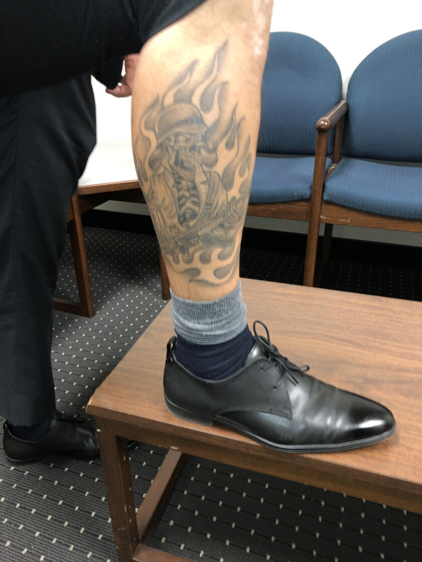 A Compton deputy's tattoo photographed as part of an excessive force lawsuit.