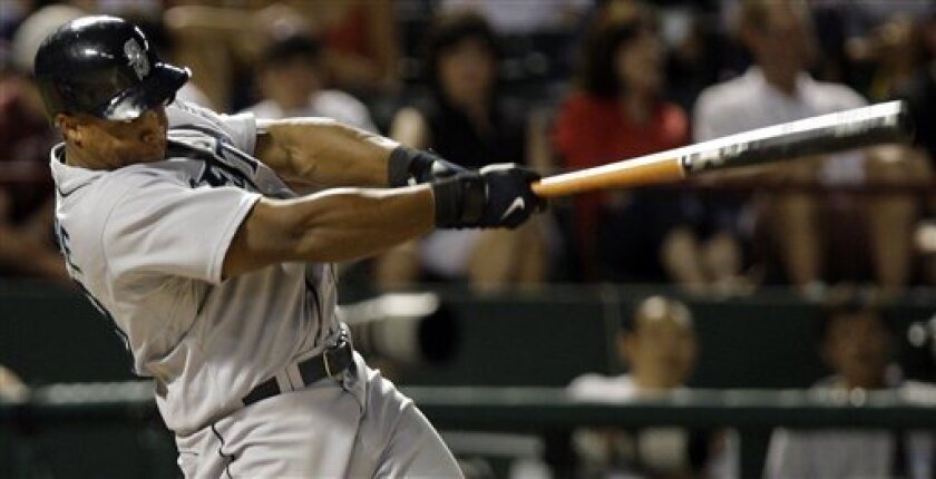 Seattle Mariners Adrian Beltre follows through on a solo home run in the eighth inning of a baseball game against the Texas Rangers in Arlington, Texas, Monday, July 28, 2008. (AP Photo/LM Otero)