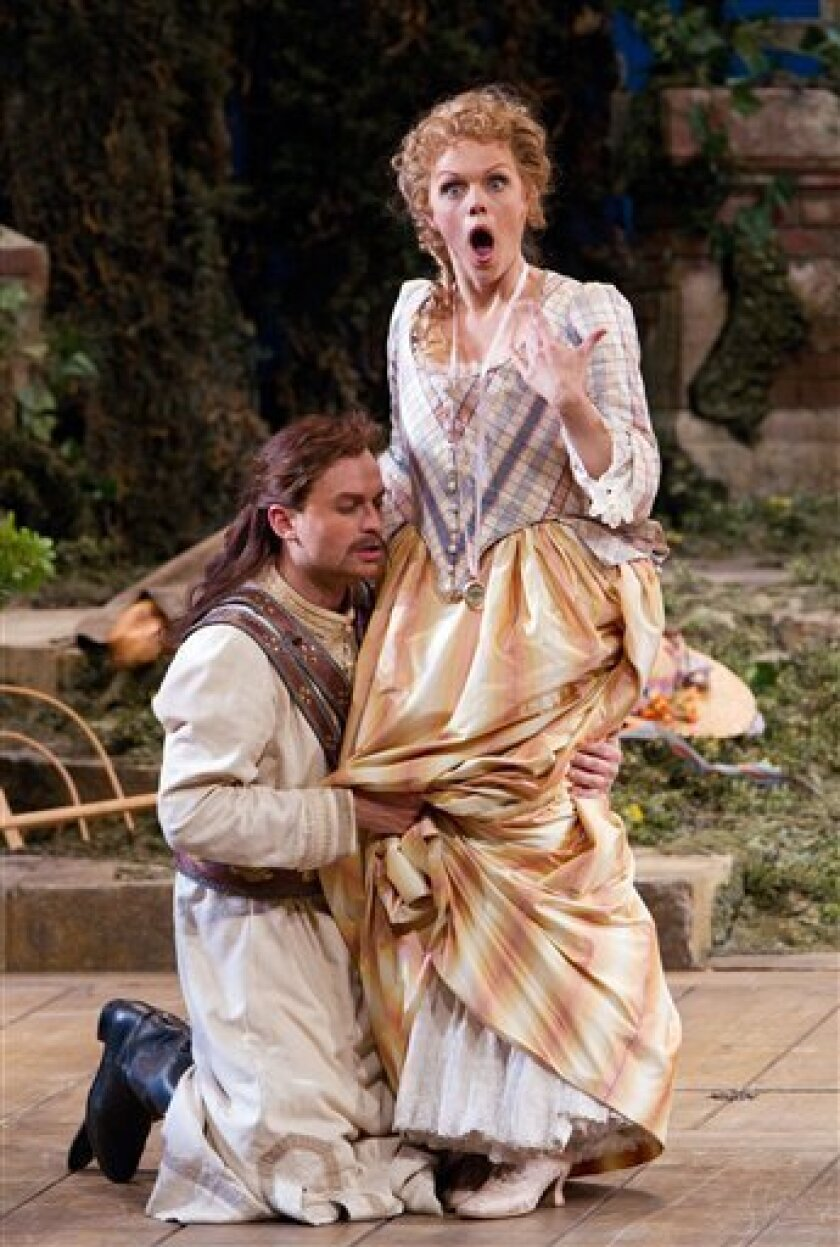 """In this Nov. 3, 2010 photo provided by the Metropolitan Opera, Mozart's """"Cosi Fan Tutte"""" is performed by Pavol Breslik as Ferrando (in disguise) and Miah Persson as Fiordiligi during the rehearsal at the Metropolitan Opera in New York. (AP Photo/Metropolitan Opera, Marty Sohl)"""