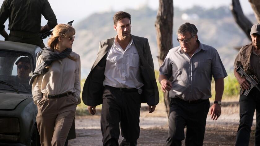 "Rosamund Pike, Jon Hamm, center, and Dean Norris in the movie ""Beirut."""