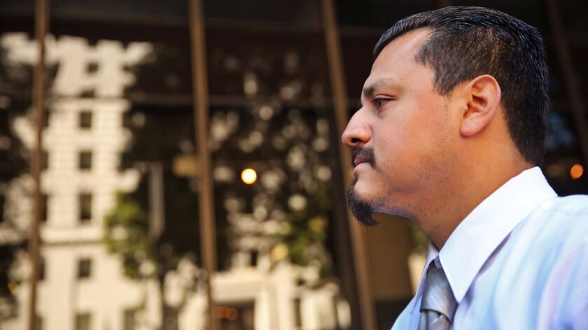 A former Los Angeles County sheriff's deputy was sentenced Monday to nine months of home detention and 640 hours of community service for lying to federal investigators about the beating of Gabriel Carrillo, above, a jail visitor.