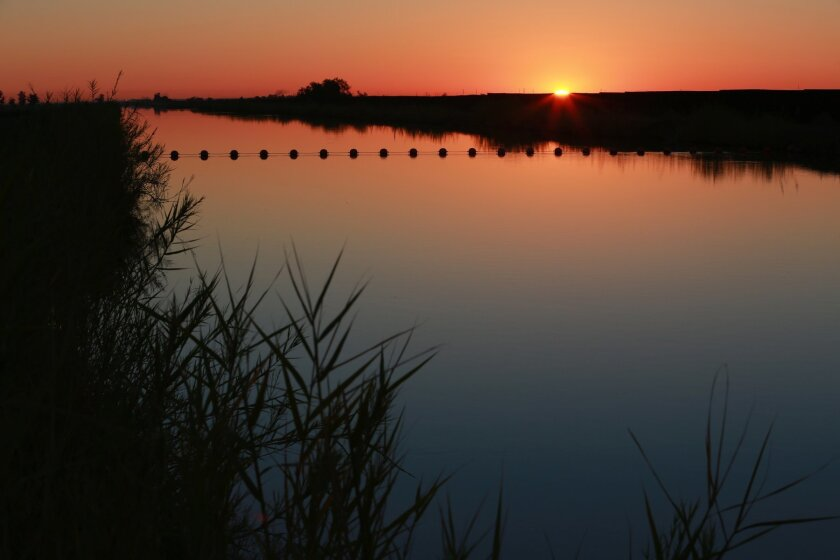 Sunrise on the All-American Canal near Pulliam Rd. in Imperial County in this 2013 file photo. The canal was lined to conserve water, made available for the San Diego County Water Authority.
