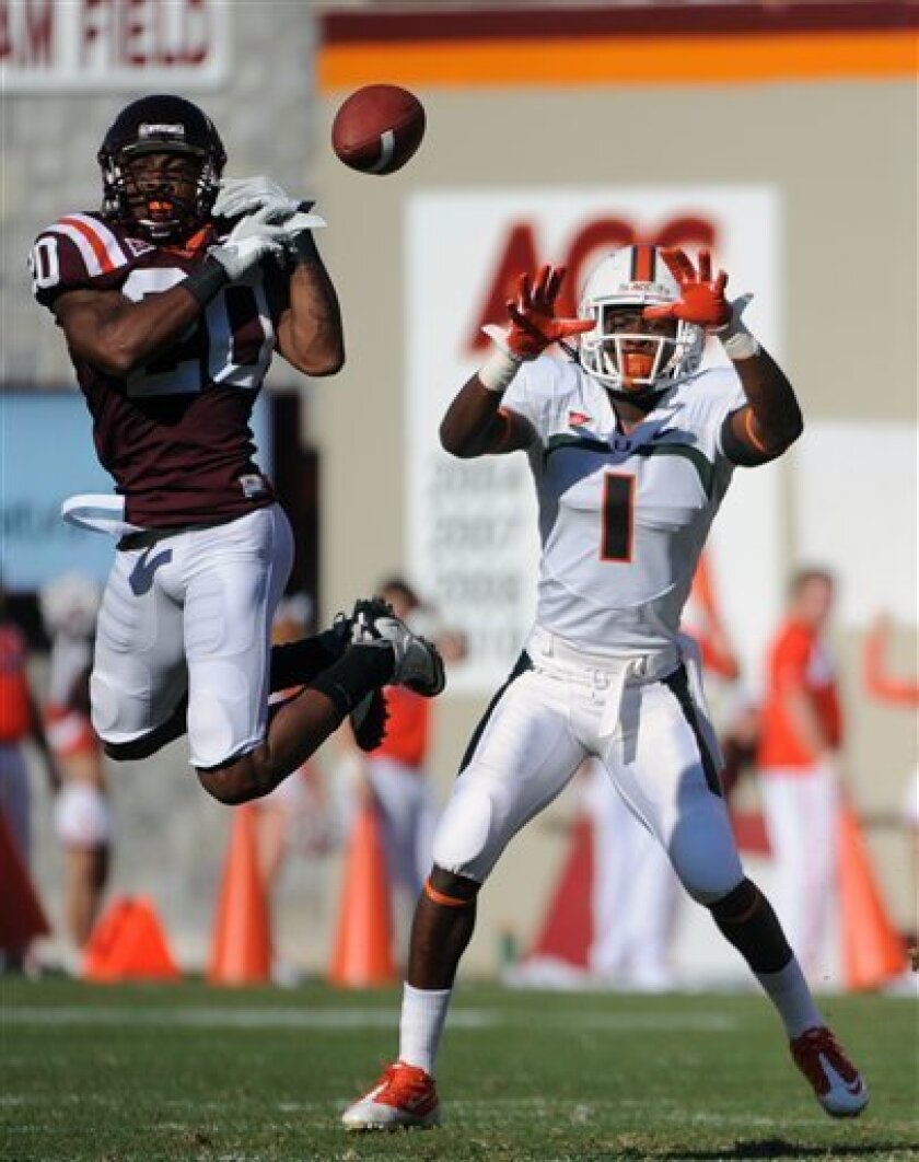 Virginia Tech's Jayron Hosley (20) breaks up a pass against Miami's Allen Hurns (1) during the first half of an NCAA college football game Saturday, Oct. 8, 2011, in Blacksburg, Va. (AP Photo/Don Petersen)