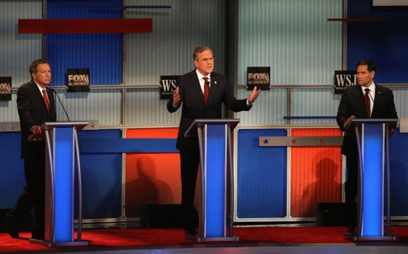 Many watched Tuesday night's debate to see whether Jeb Bush, center, would make a showing, while others watched to see how Fox Business, which moderated the debate, would react.
