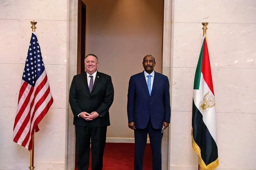 U.S. Secretary of State Mike Pompeo stands with Sudanese Gen. Abdel-Fattah Burhan in Khartoum, Sudan, on Aug. 25.