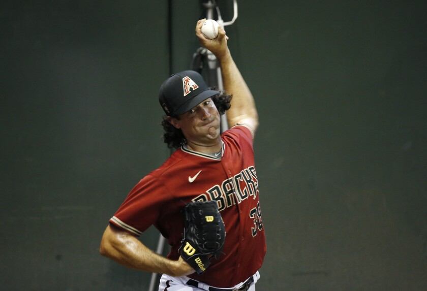 Arizona Diamondbacks starting pitcher Robbie Ray warms up in the bullpen during team baseball practice at Chase Field, Friday, July 3, 2020, in Phoenix. (AP Photo/Ross D. Franklin)