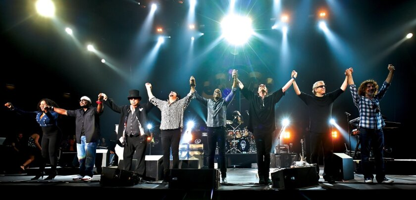 The band Toto takes a bow at the end of a concert. Photo by Darek Kawka