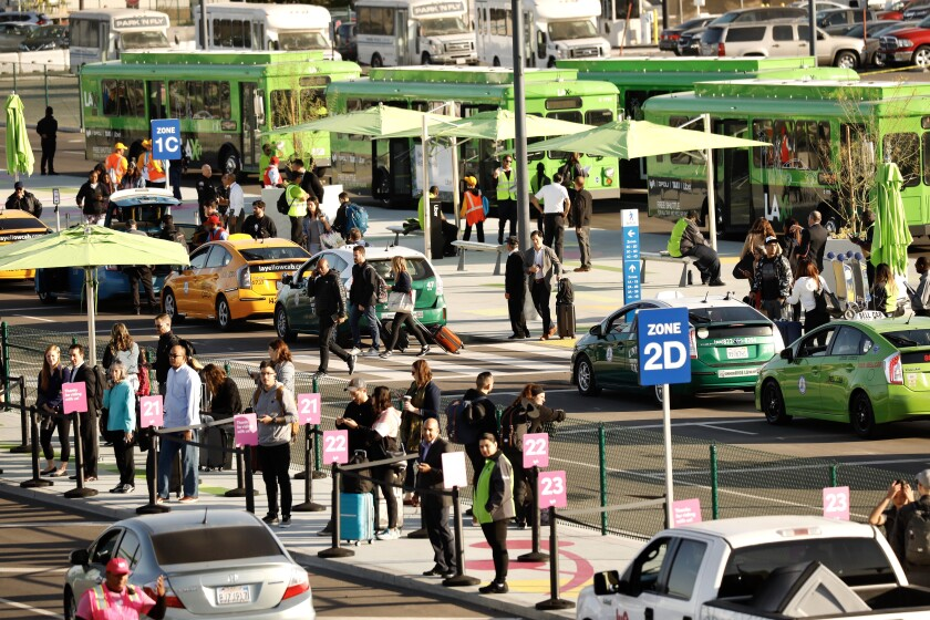 Shuttle bus at LAX ride-hailing pickup area