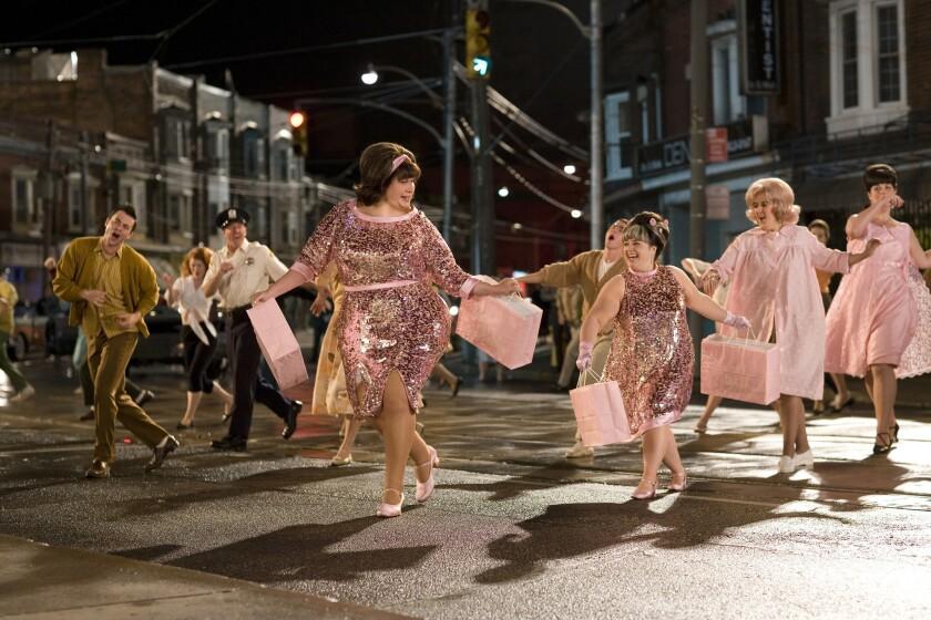 "John Travolta and Nikki Blonsky in the 2007 movie ""Hairspray."""