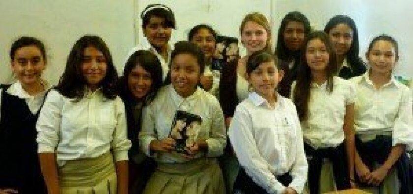 Emma Halpern with Nativity Prep Book Club students.