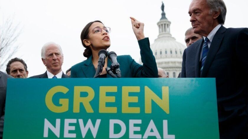 """Rep. Alexandria Ocasio-Cortez (D-N.Y.) speaks about the proposed """"Green New Deal"""" with other congressional supporters of the plan in Washington on Feb. 7."""
