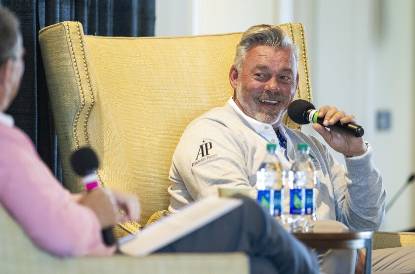 Golfer Darren Clarke, right, talks with Hank Adler, left, during the Hoag Classic's Breakfast with a Champion at Newport Beach Country Club on Tuesday.