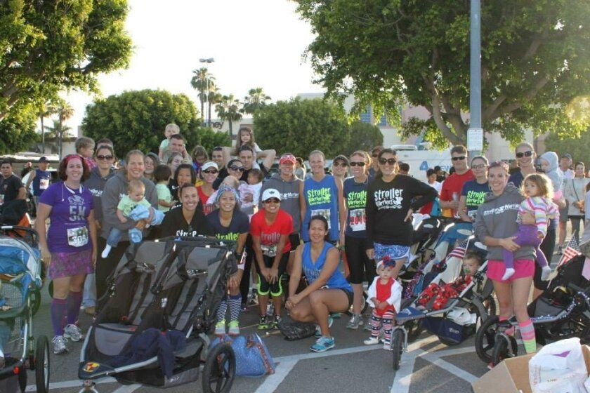 Camp Pendleton Stroller Warriors gather at a team race last year at Laguna Hills honoring 3rd Battalion 5th Marines. Photo by Rachel Kennedy.