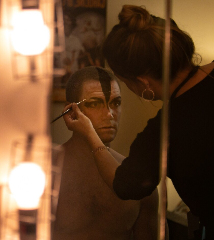 Max Westwell, who alternates as the Swan, has the signature Bourne makeup applied backstage.