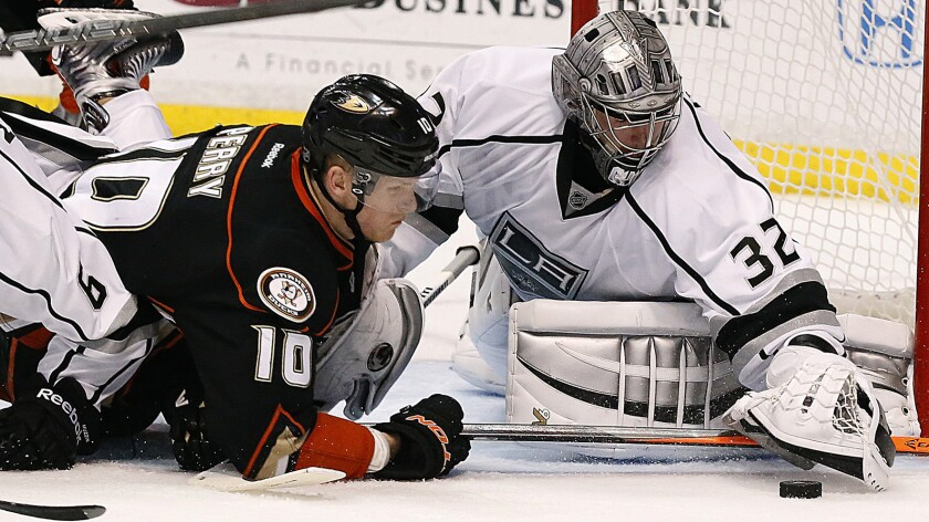 Kings goalie Jonathan Quick moves to cover the puck in front of Ducks forward Corey Perry during the Ducks' season-ending loss in Game 7 of the Western Conference semifinals Friday. Perry says the Ducks' playoff exit could act as a motivating factor for next season.