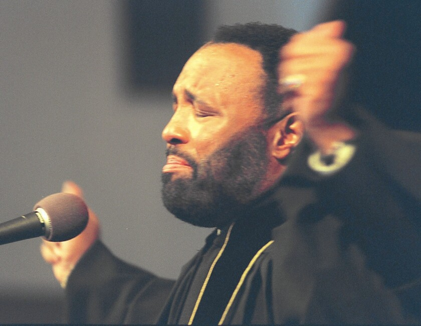 Andrae Crouch leads Sunday services at Christ Memorial Church of God in Christ in San Fernando, where he was co-pastor with his sister. Crouch built his songs around themes of salvation, renewal and the glory of everyday life.