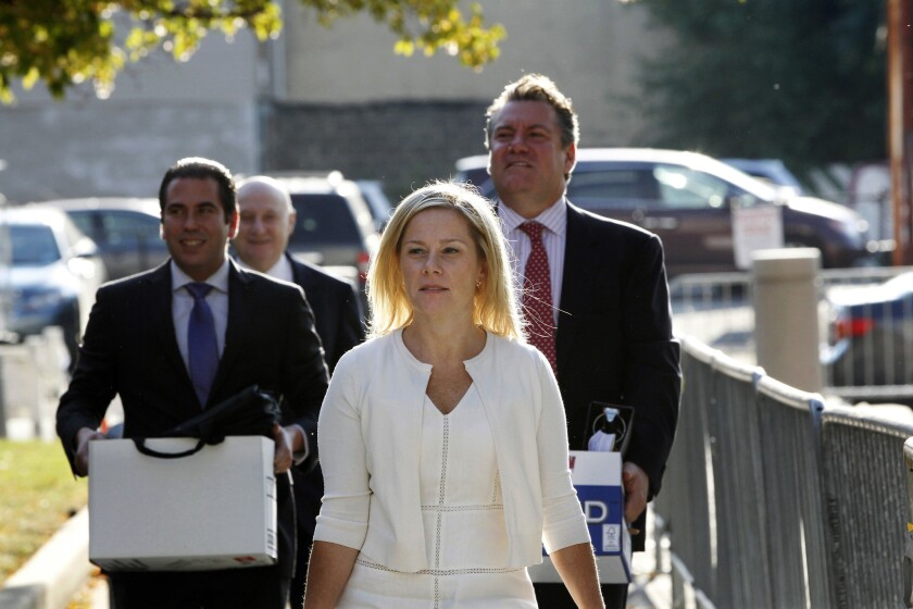 Gov. Chris Christie's former Deputy Chief of Staff, Bridget Kelly, center, arrives at Martin Luther King Jr. Courthouse in Newark, N.J., with her attorneys Michael Critchley Jr., right, and Michael Critchley, back second left.