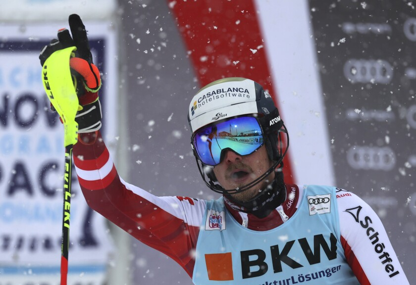 Austria's Manuel Feller reacts after completing an alpine ski, men's World Cup slalom in Flachau, Austria, Saturday, Jan. 16, 2021. (AP Photo/Alessandro Trovati)