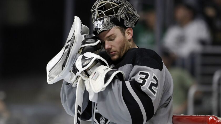 Kings goaltender Jonathan Quick takes a breather after giving up a goal to the Panthers' Jonathan Huberdeau during the third period Saturday.