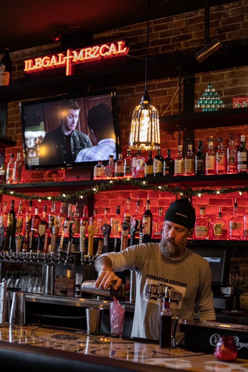 A bartender serving up drinks at Metl Bar & Restaurant