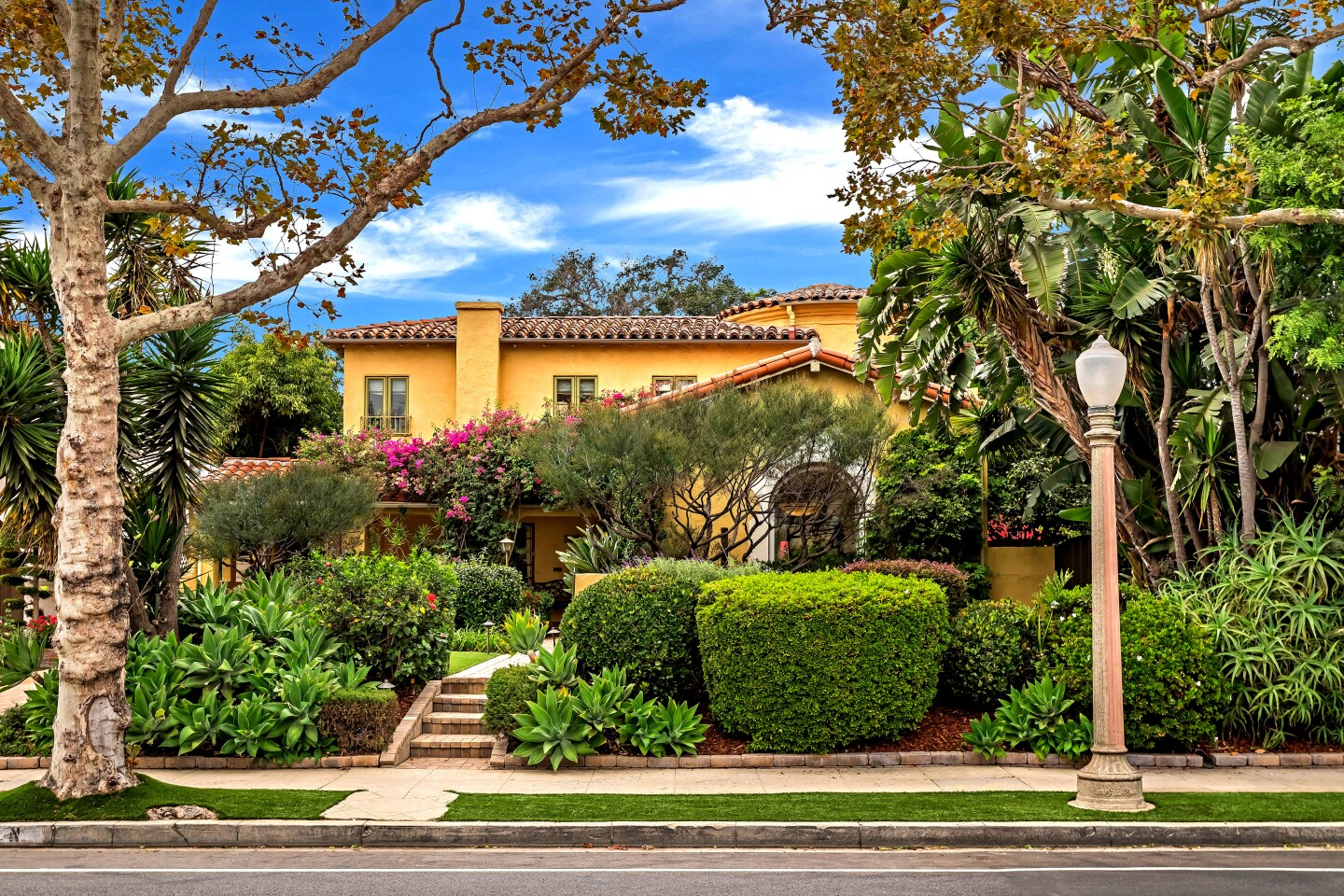 Built in 1929, the charming Spanish Revival-style home was once owned by a pair of Getty Center architectural historians. Living spaces filled with period charm open to a landscaped backyard with fountains and a spa.