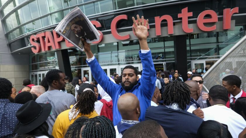 Fans of rapper Nipsey Hussle wait in line to attend a public memorial at Staples Center in Los Angel