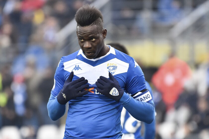 FILE - In this Sunday, Feb. 9, 2020 filer, Brescia's Mario Balotelli reacts during the Italian Serie A soccer match between Brescia and Udinese at the Mario Rigamonti stadium in Brescia, Italy. The former Italy striker was reportedly fired by his hometown club for failing to report for training as the Italian soccer season prepares to resume from a three-month break due to the coronavirus pandemic. (Gianluca Checchi/LaPresse via AP, File )