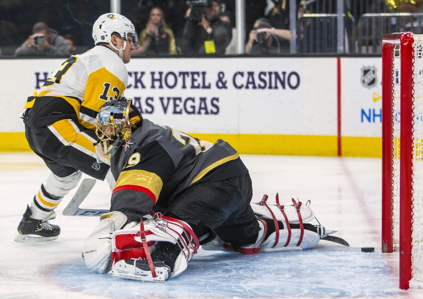 Pittsburgh Penguins' Brandon Tanev (13) scores on Vegas Golden Knights goaltender Marc-Andre Fleury (29) during the third period of an NHL hockey game Tuesday, Jan. 7, 2020, in Las Vegas. (AP Photo/L.E. Baskow)