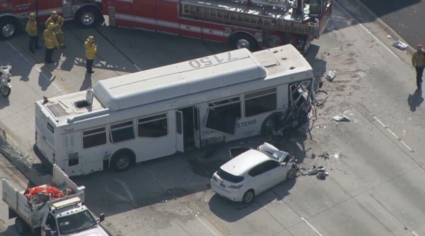 An aerial image from video provided by KABC-TV shows the wreckage of a bus crash on the 405 Freeway in Los Angeles on Sunday. Authorities say at least 25 people were injured when the bus crashed through a concrete divider on the highway and struck other vehicles.