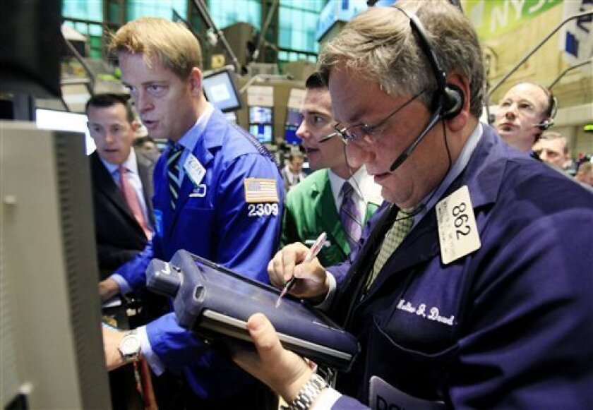 Traders work on the floor of the New York Stock Exchange at the post that handles Citigroup Monday, May 4, 2009. (AP Photo/Richard Drew)