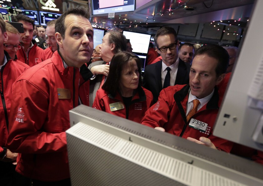 Lending Club founder and then-CEO Renaud Laplanche, left, is seen at the New York Stock Exchange the day of the company's IPO in 2014.