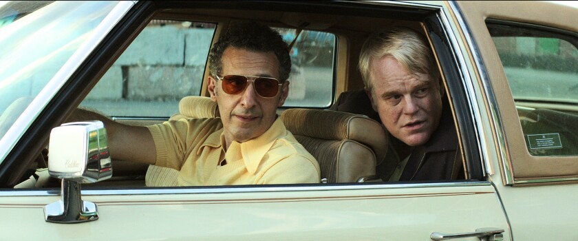 "John Turturro, left, and Philip Seymour Hoffman star in ""God's Pocket."""