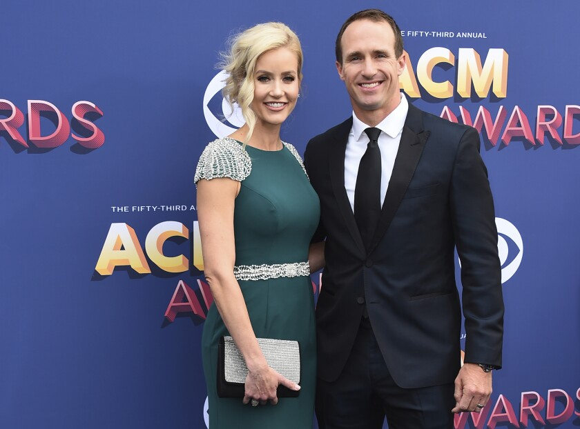 "FILE - In this April 15, 2018 file photo, Brittany and Drew Brees arrive at the 53rd annual Academy of Country Music Awards at the MGM Grand Garden Arena in Las Vegas. New Orleans Saints Quarterback Drew Brees has apologized for comments he made in an interview regarding his opposition to Colin Kaepernick's kneeling during the national anthem. His wife apologized on Saturday, June 6, 2020, as well, saying ""we are the problem."" (Photo by Jordan Strauss/Invision/AP, File)"