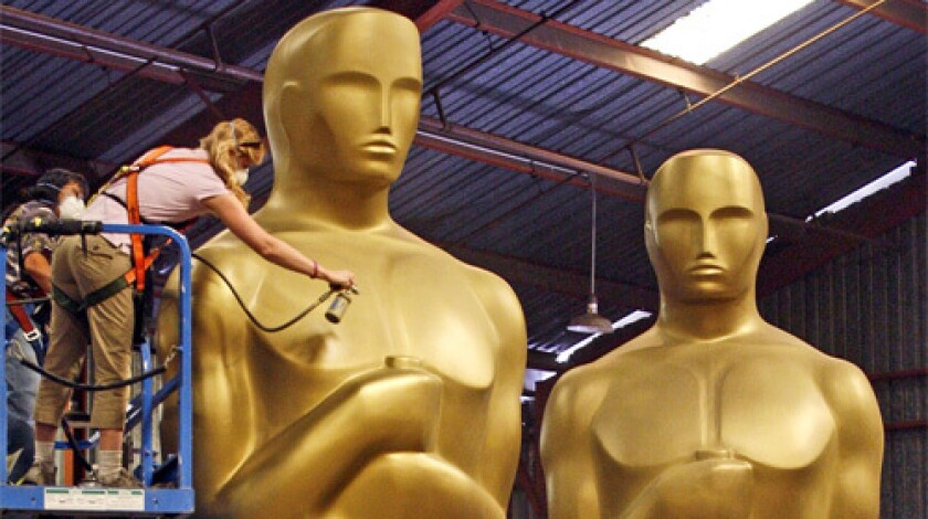 An artist paints Academy of Motion Picture Arts and Sciences Oscars prop statues at a warehouse in this Oct. 2007 file photo.