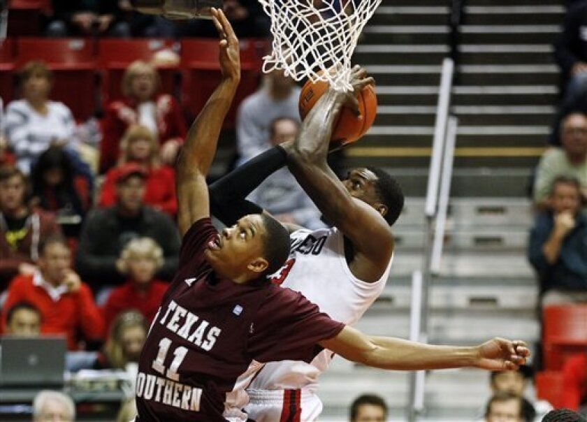 San Diego State forward Deshawn Stephens shoots over Texas Southern's Lawrence Johnson-Danner (11) during the first half of their NCAA college basketball game, Monday Dec. 3, 2012, in San Diego. (AP Photo/Lenny Ignelzi)