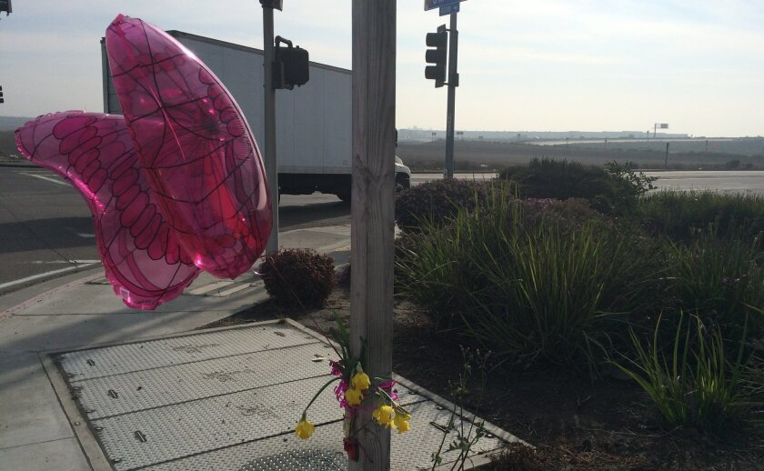 A small bouquet of yellow flowers and a butterfly-shaped balloon marked the location where Noemi Mendez was fatally struck by a semi-truck Wednesday evening.