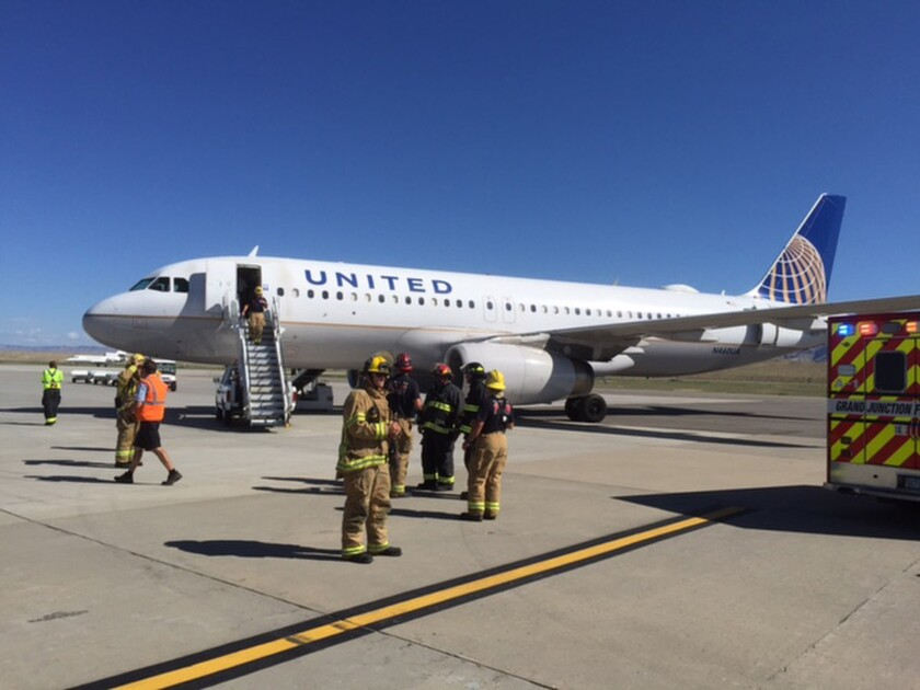 A United Airlines jet en route from Denver to Los Angeles was diverted to Grand Junction, Colo., and met by firefighters after several passengers reported feeling ill.
