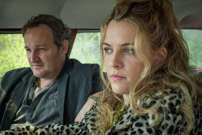 "Jason Clarke and Riley Keough in the movie ""The Devil All the Time."""