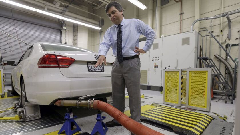 A California Air Resources Board spokesman shows how a 2013 Volkswagen Passat with a diesel engine is evaluated at the emissions test lab in El Monte in 2015.