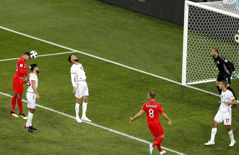 Dele Alli of England (L) in action during the FIFA World Cup 2018 group G preliminary round soccer match between Tunisia and England in Volgograd, Russia, 18 June 2018.