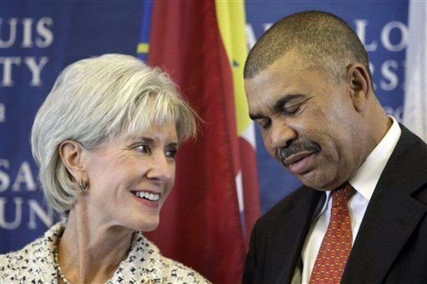 Health and Human Services Secretary Kathleen Sebelius, talks, speaks with U.S. Rep. Wm. Lacy Clay, D-Mo., right, as they are introduced during a news conference covering the H1N1 flu vaccine at Saint Louis University's Center for Vaccine Development Tuesday, Oct. 6, 2009, in St. Louis. (AP Photo/Jeff Roberson)