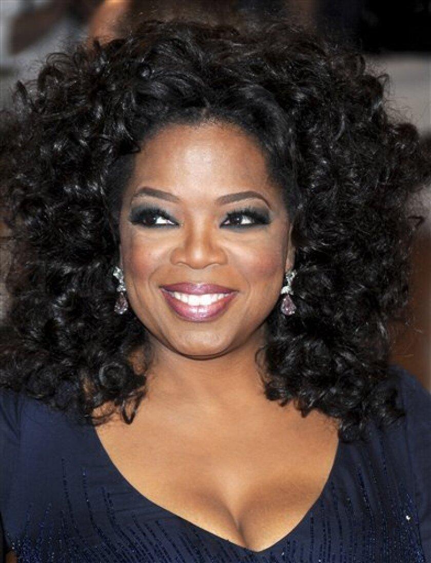FILE - In this May 3, 2010 file photo, Oprah Winfrey arrives at the Metropolitan Museum of Art Costume Institute gala in New York. (AP Photo/Evan Agostini, file)